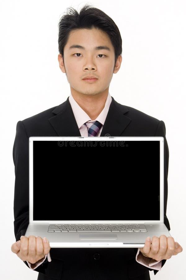 Man och dator arkivbild