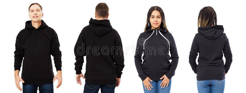 Man och kvinna i svart hoodieåtlöje upp uppsättningen som isoleras på vit bakgrund, tom svart huv arkivbild