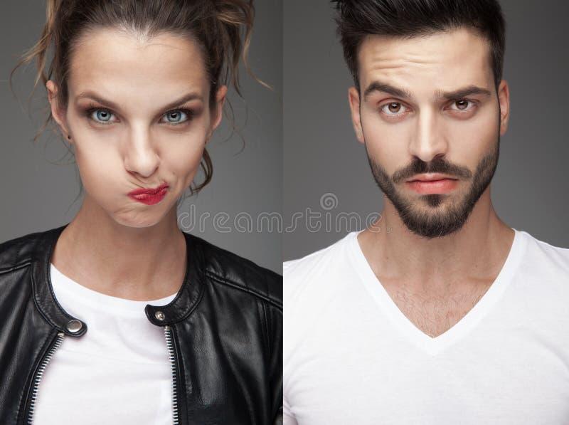 Man och kvinna som gör roliga framsidor arkivfoto