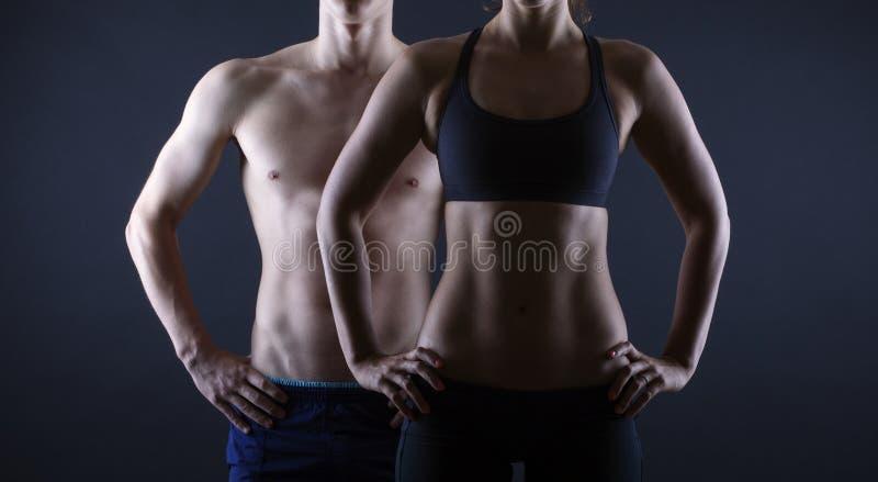 Man- och kvinnas torso arkivbilder