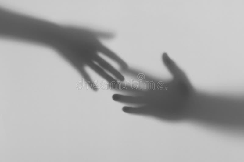 Man och kvinnlighandhandlag arkivfoton