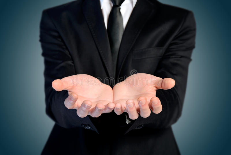 Man offer hand. And holding nothing royalty free stock photos