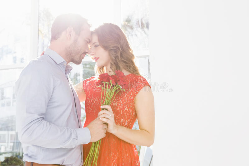 Man offering flower bouquet to woman stock photography
