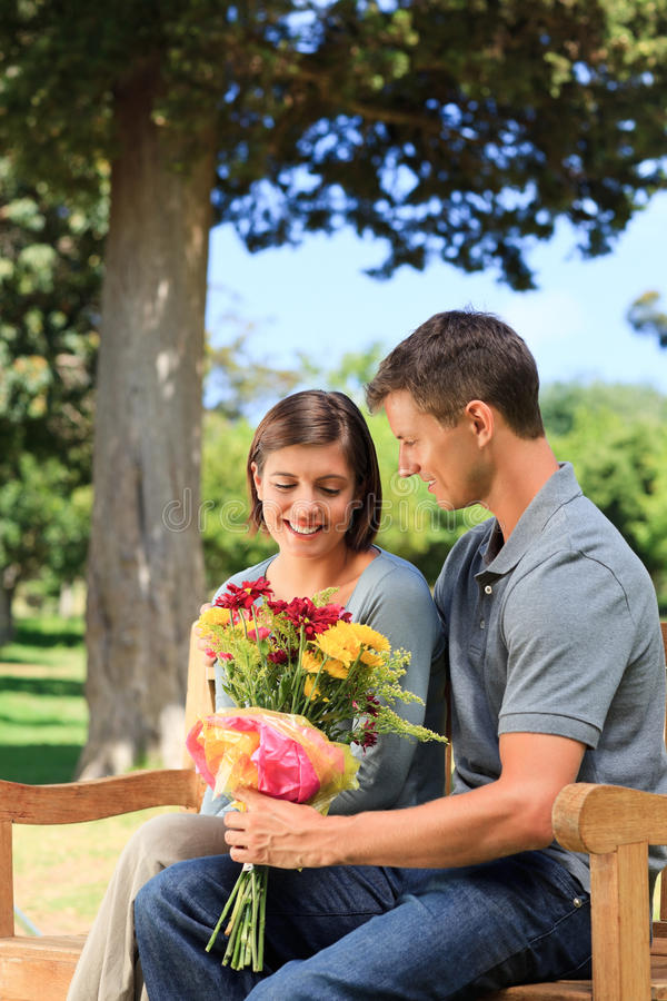 Download Man Offering Flowers To His Girlfriend Stock Photo - Image of green, carefree: 18738980