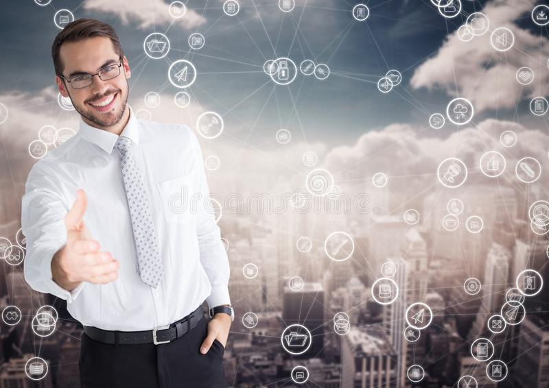 Man offering hand for handshake and cityscape with connecting icons in background. Digital composition of man offering hand for handshake with cityscape and stock photography