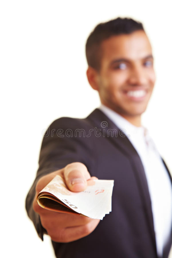 Man offering money. Young business man offering a stack of money stock images