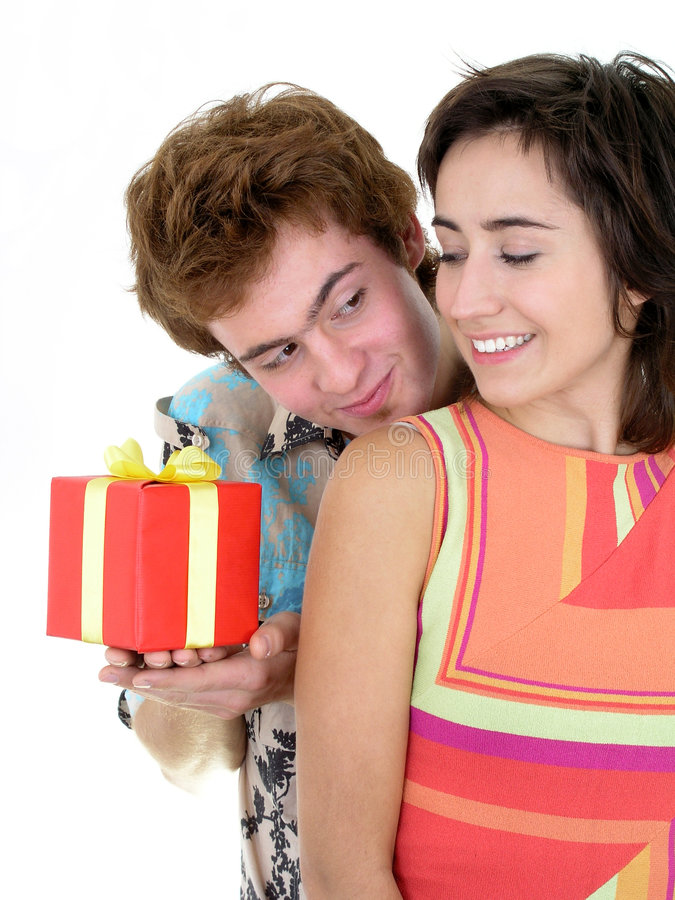 Man Offering Present to Girlfriend royalty free stock photography