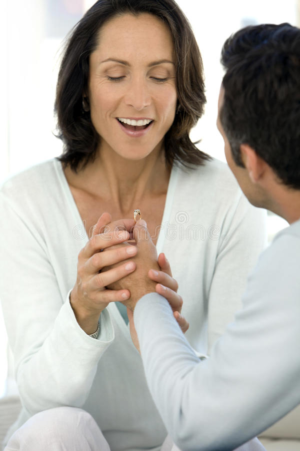 Man offering a ring to a woman stock photography