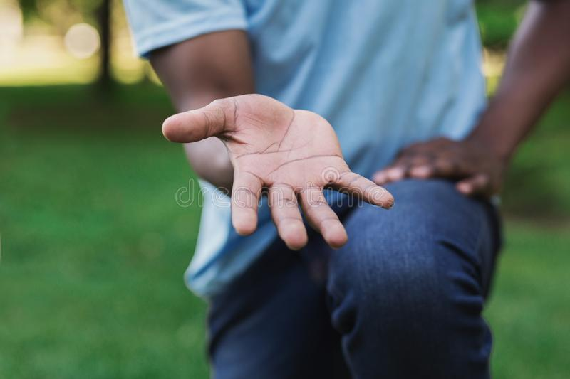 Man offering something in empty hand to camera royalty free stock image