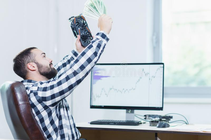 A man in the office buys a video card. Cryptocurrency. stock photography