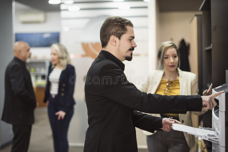 Man in office sending fax or printing files royalty free stock photos