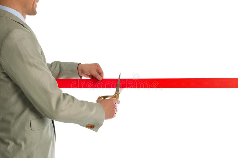 Man in office suit cutting red ribbon, closeup. Man in office suit cutting red ribbon isolated on white, closeup stock photos