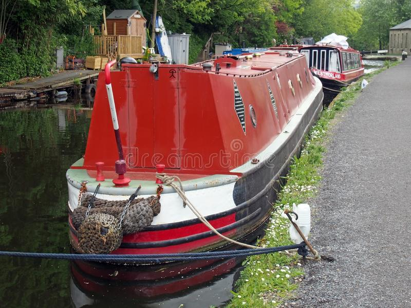 A man on the old barges at the narrow boats club gathering held on the may bank holiday on the rochdale canal at hebden bridge in. Hebden bridge, west yorkshire royalty free stock photo