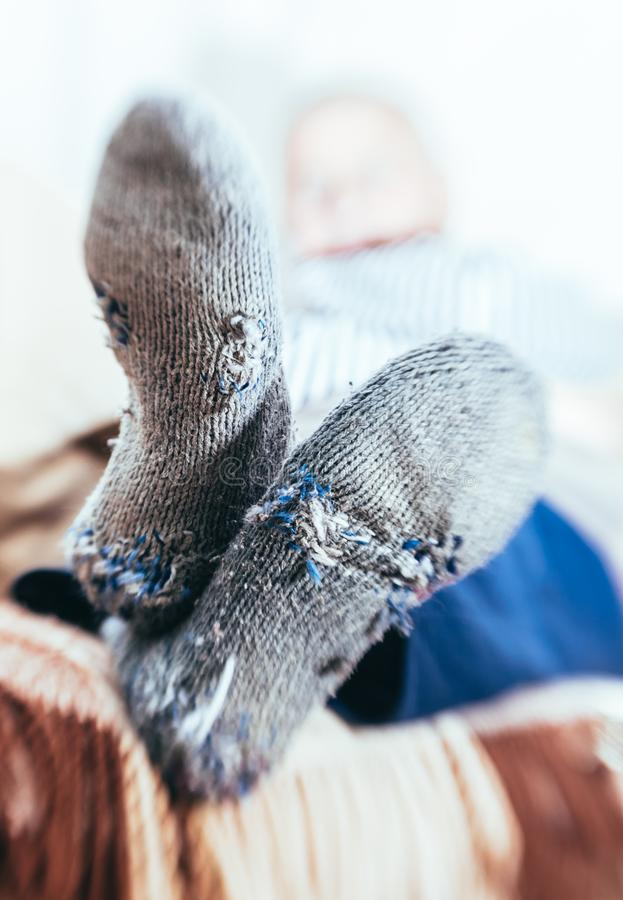Man in old socks with holes royalty free stock photo