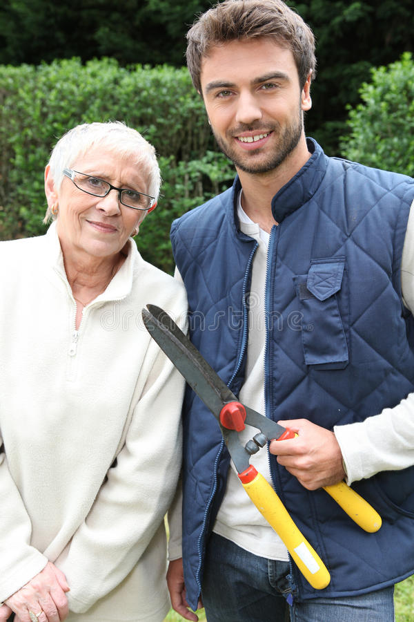 Man And Older Woman In Garden Stock Photo