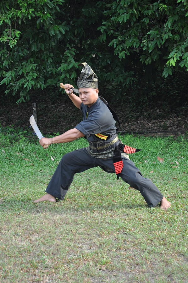 A man in a one of costume of Malaysia martial arts culture royalty free stock photos
