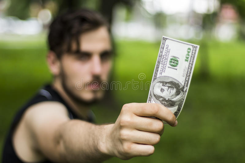 Man one hundred dollars royalty free stock photos