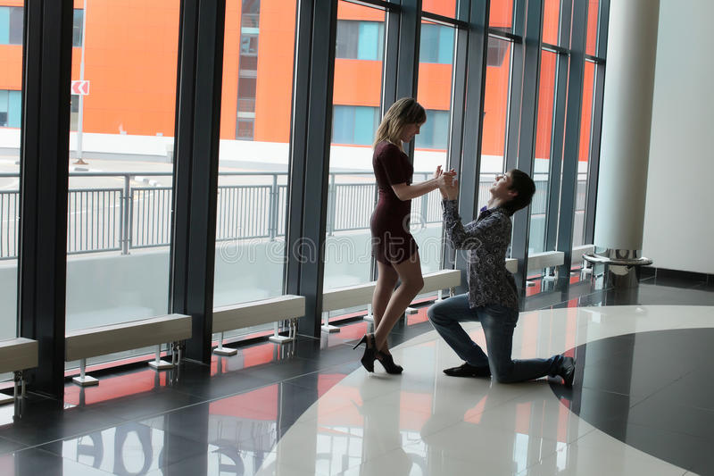 Download Man On One Knee Before Woman Royalty Free Stock Photography - Image: 19386237