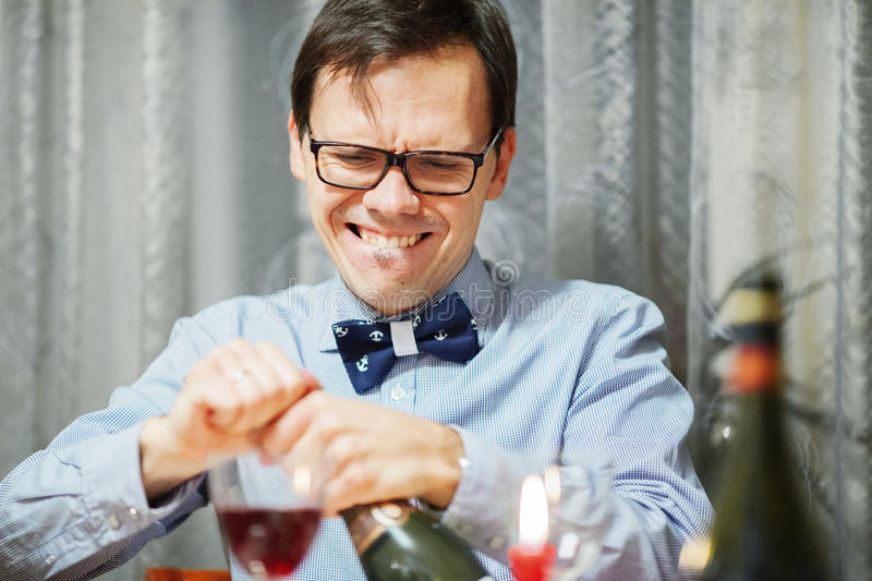 Download Man open the bottle stock image. Image of emotion, year - 56598175