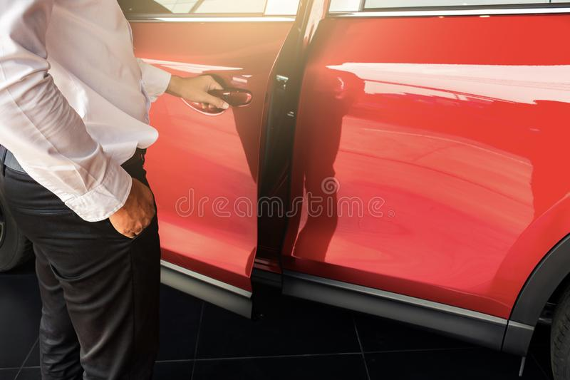 Man open red car door with smart keyless For automotive or transportation image royalty free stock image