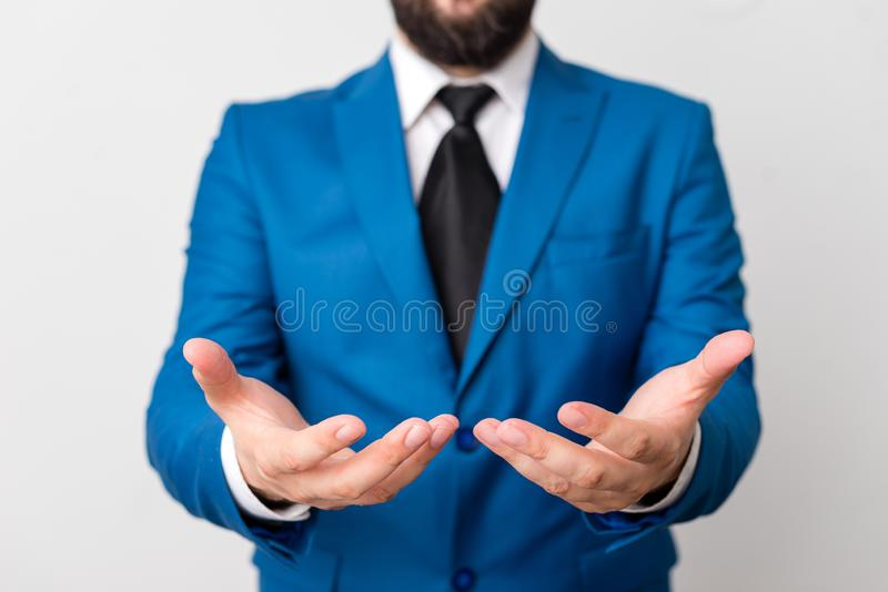 Man with opened hands in fron of the table. Mobile phone and notes on the table. Business concept with man in the suite. Man with opened hands in fron of the stock image