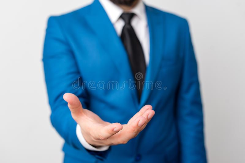 Man with opened hands in fron of the table. Mobile phone and notes on the table. Business concept with man in the suite. Man with opened hands in fron of the stock photos