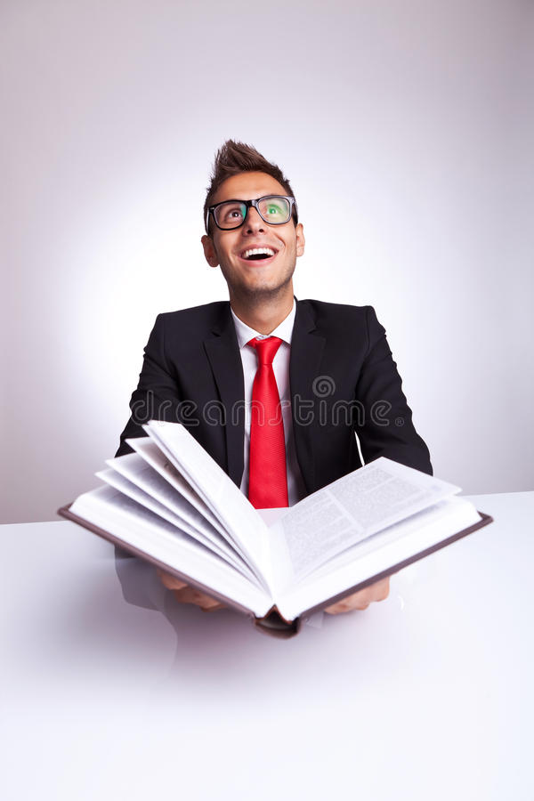 Man opening a book with lots of knowledge wonders stock photo