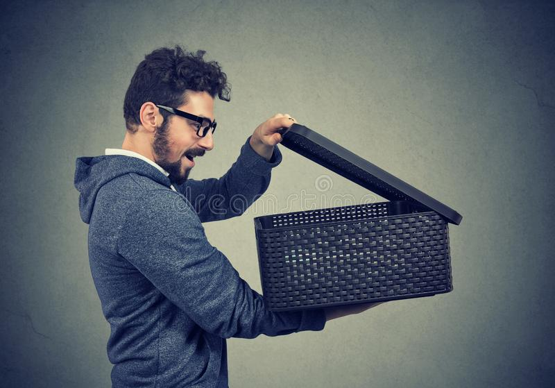 Man opening a box with something exciting inside it stock images