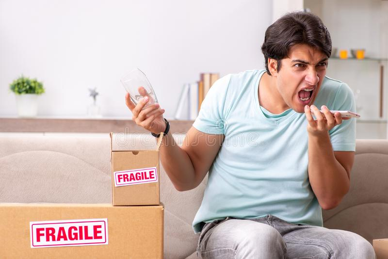 The man opening fragile parcel ordered from internet royalty free stock photos