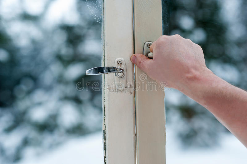 Man opens old windows. Winter view royalty free stock images
