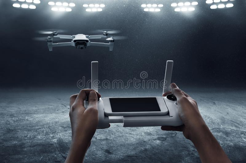 Man operating drone with remote control. Man operate drone with remote control royalty free stock images