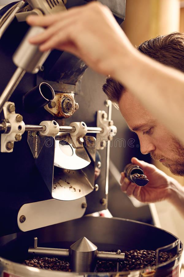 Free Man Operating A Modern Coffee Roasting Machine And Smelling The Royalty Free Stock Photo - 65629435