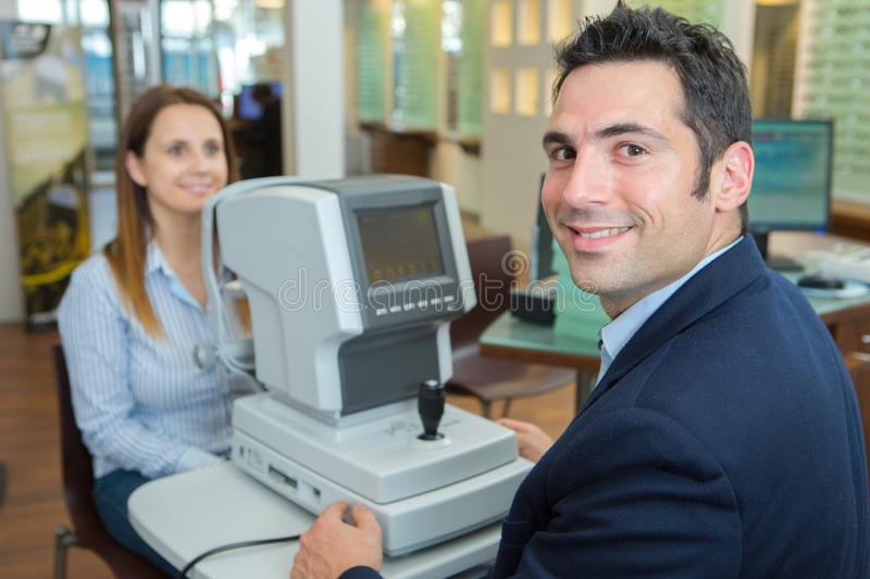 Man in optics store having ophthalmologist examination. Man royalty free stock image