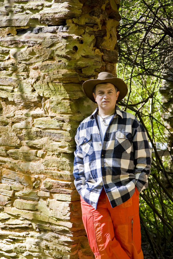 Download Man In Orange And Plaid On Rock Wall Stock Image - Image: 9757249