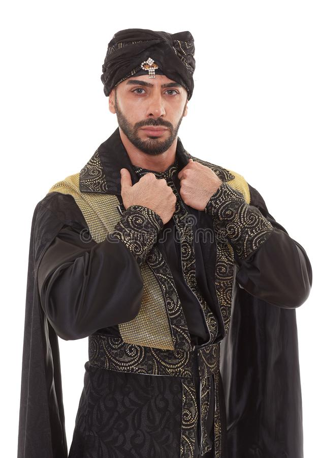 Man in oriental costume. Handsome strong courageous man in oriental costume stands on a white background stock photography