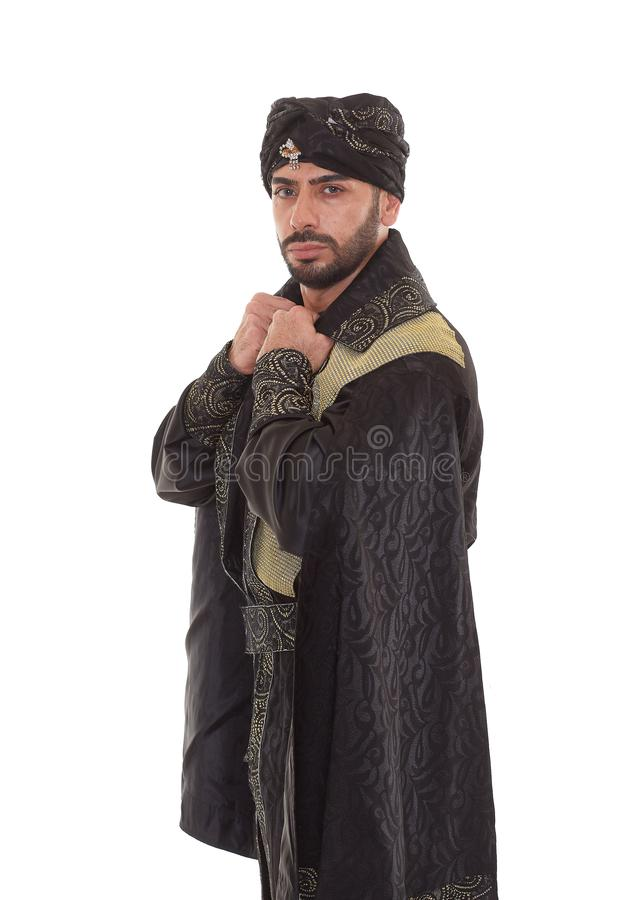 Man in oriental costume. Handsome strong courageous man in oriental costume stands on a white background stock images