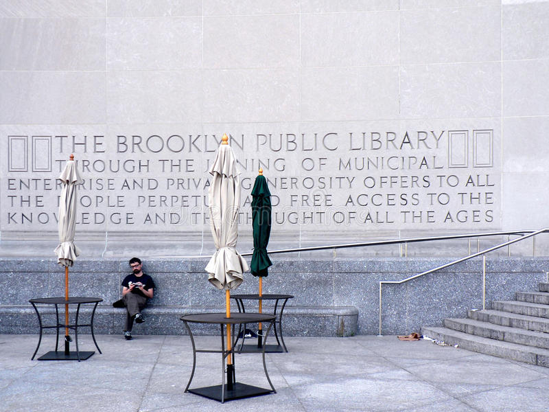 Man outside Brooklyn Public Library royalty free stock images