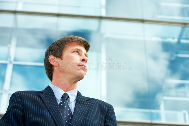 Man outside office building royalty free stock photography