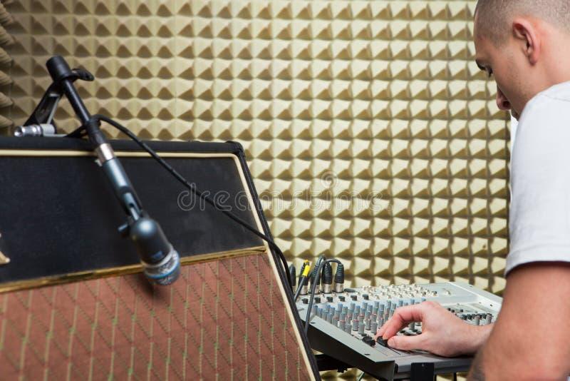 Man over mixer board royalty free stock photos