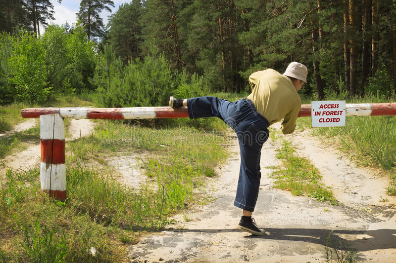 Man Overcomes Barrier In Fire-dangerous Period, Ignoring Ban Stock Photo