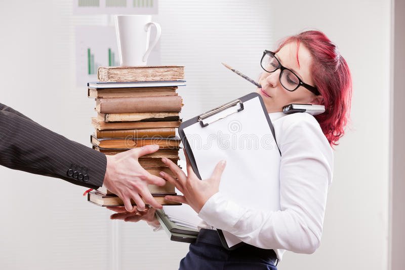 Man overloading colleague woman with work royalty free stock image