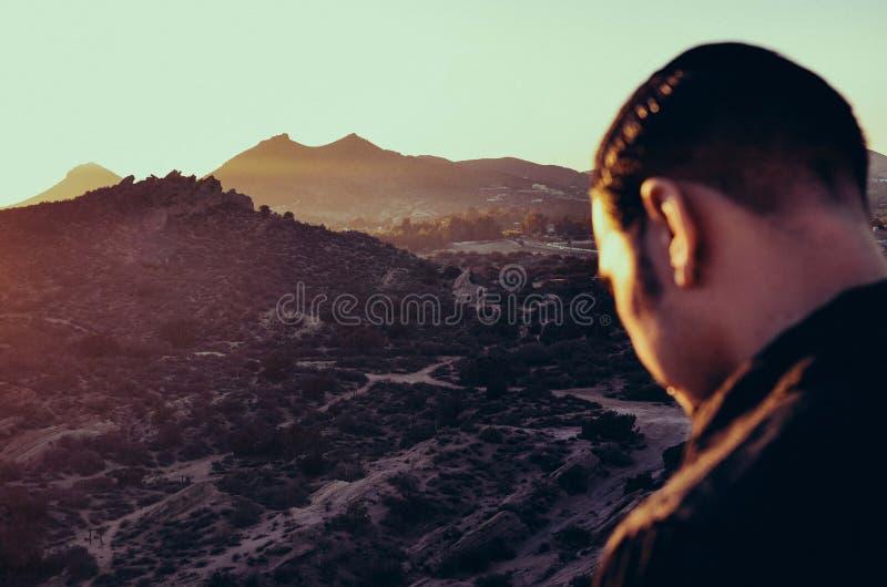 Man overlooking mountain valley stock photo