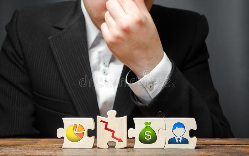 Man from overstrain holds his hand on the nose or forehead on the background of the business process insolvency visualization. Wrong business model stock photos