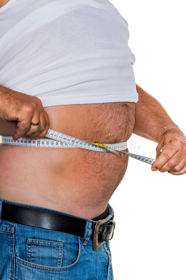 Man with overweight. Symbolic photo for beer belly, unsuccessful diets and poor diet royalty free stock image