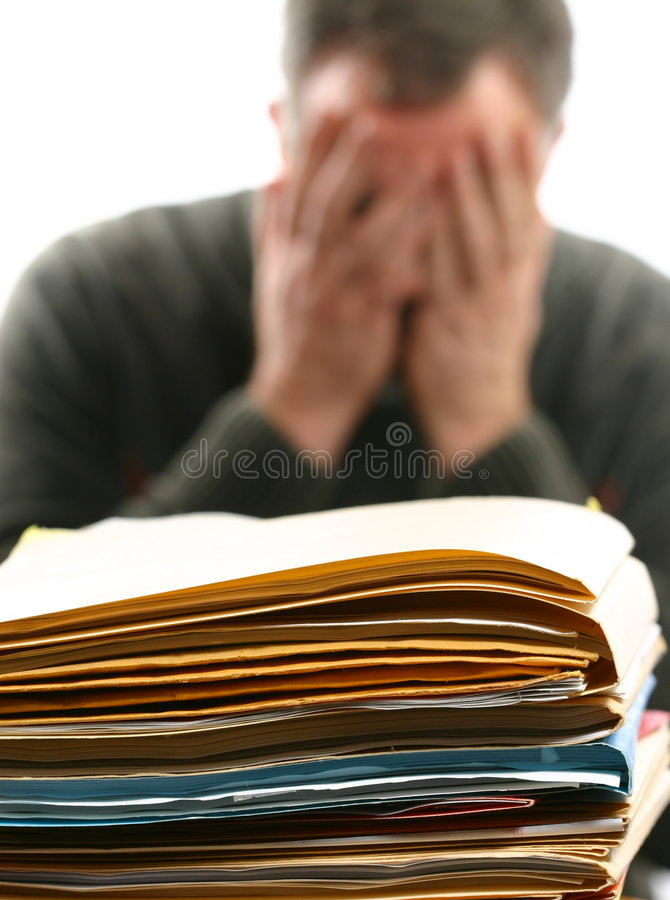 Man Overwhelmed With Office Work Royalty Free Stock Photography