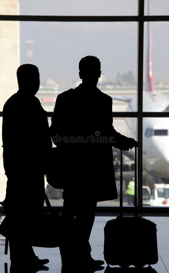 Flygplatspasenger royaltyfria bilder