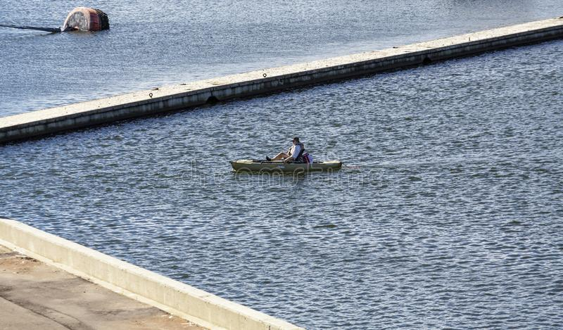 Man in Paddle Boat. CHARLOTTETOWN, PRINCE EDWARD ISLAND - September 24, 2015: Charlottetown is the capital Canadian province of Prince Edward Island, Tourism is royalty free stock image