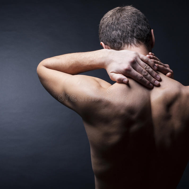 Man with a pain in the neck stock images