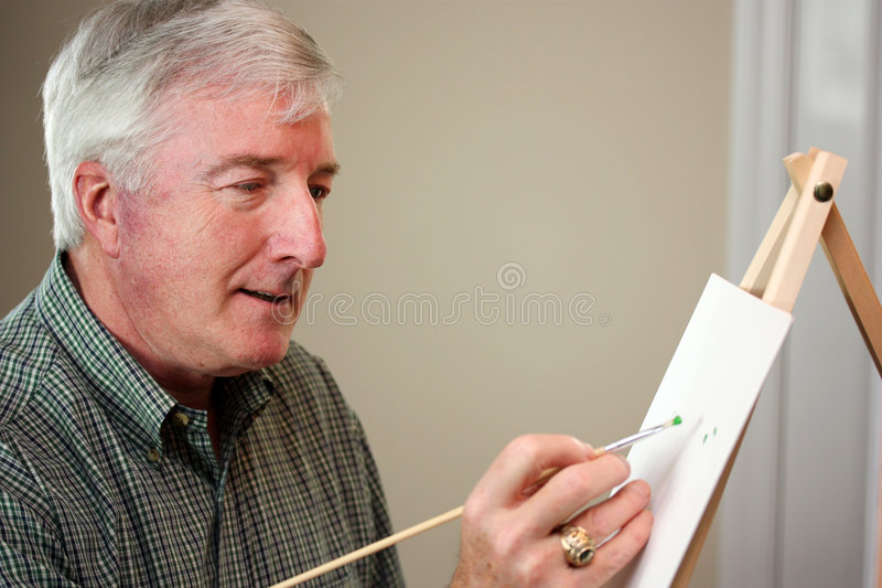 Man Painting stock images