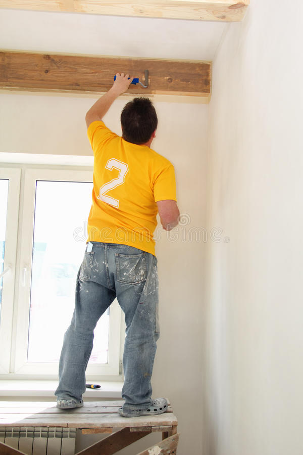 Free Man Painting A Exposed Beams Royalty Free Stock Photos - 30261308